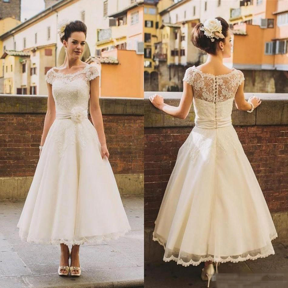Aliexpress buy 2017 wedding dresse new vintage tea length aliexpress buy 2017 wedding dresse new vintage tea length lace wedding dresses a line beach appliques sheer cap sleeves short bridal gowns from ombrellifo Images