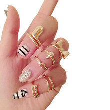 2019 hot sell 7Pcs Punk Gold Color Skull Bowknot Heart Mid Finger Top Stacking Rings Set 56LV(China)
