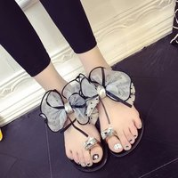 2016 lente en zomer diamant boog platte slippers Waichuan mode bloemen vrouwelijke Teen kristal strand sandalen en slippers