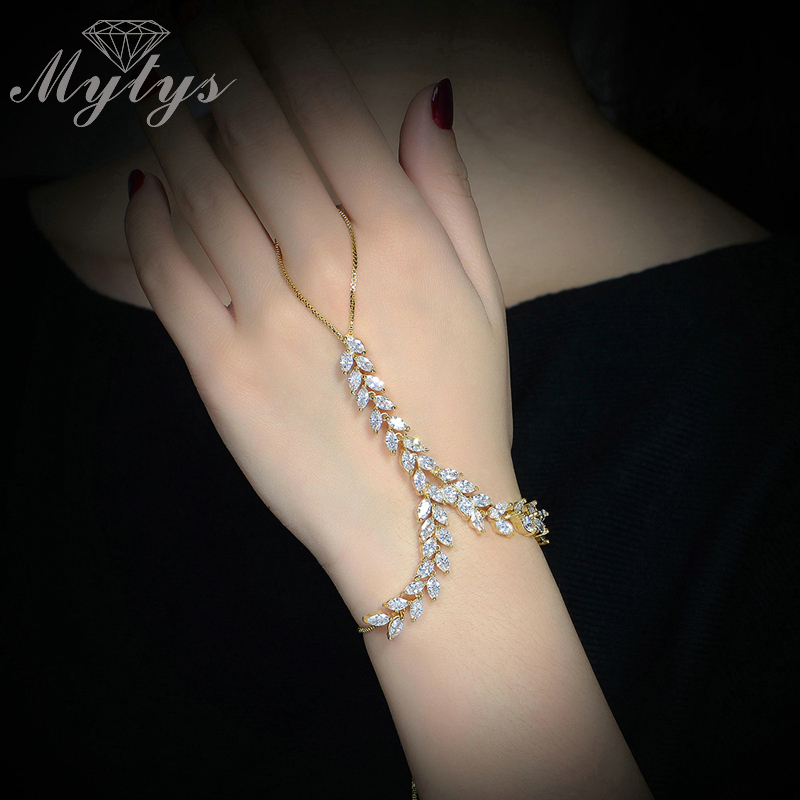 цены Mytys GP High Quality Zircon Prong Setting Leaf Design Slave Bracelet Connected Fingers Palm Bracelet R1112