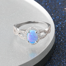 Elegant Sterling Silver Ring With Oval Blue Opal Main Stone