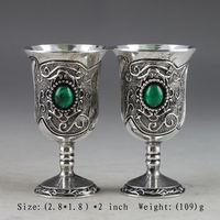 Un Cinese antico manuale di acquisizione di una coppia di Miao argento intarsiato verde tazza