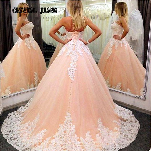 Strapless sleeveless lace appliques peach wedding dresses 2017 with strapless sleeveless lace appliques peach wedding dresses 2017 with corset back court train bridal gown customized junglespirit Images