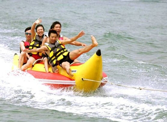 inflatable banana boat  4 people playing on the beach surf riding water game water toys summer necessary water park funny summer inflatable water games inflatable bounce water slide with stairs and blowers