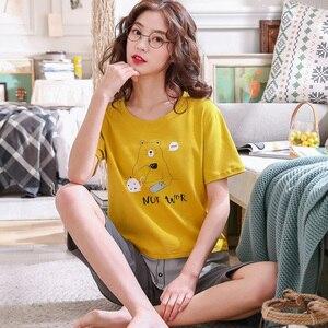 Image 2 - Pijamas de algodón con dibujos animados para mujer, ropa de 100% de manga corta con cuello redondo, M XXL de talla grande