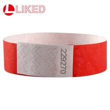04dac1bb934f De nuevo de Color rojo 3 4 pulgadas pulseras Tyvek con números de serie de pulseras  para fiesta eventos 500 piezas envío gratis