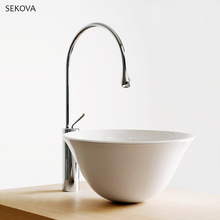 купить Black & Chrome Brass Drop-shaped Kitchen Sink Faucet Mixer Cold And Hot Single Handle Swivel Spout Kitchen Water Sink Mixer Tap по цене 8409.88 рублей
