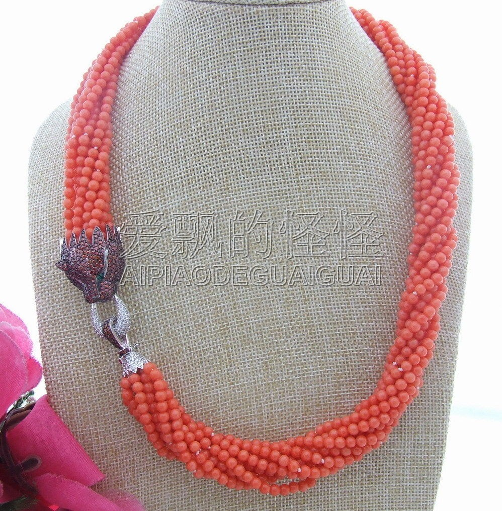 N040303 10 brins collier rond corail Orange et fermoir CzN040303 10 brins collier rond corail Orange et fermoir Cz