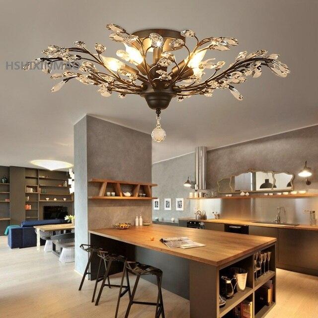 US $124.96 26% di SCONTO|Vintage stile Europeo e Americano lampadario  dorato nero salotto camera da letto lampada di cristallo ristorante  business ...
