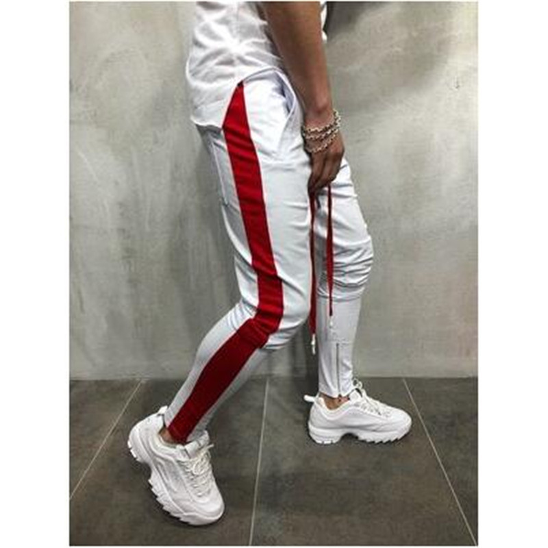 Hip hop pants men 39 s casual sports pants fashion stitching casual pants men 39 s personality foot zipper decorative hip hop pants in Harem Pants from Men 39 s Clothing