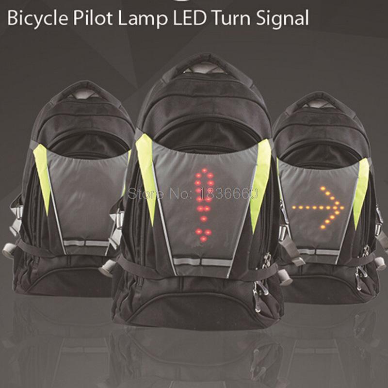 Prix pour 2016 Nuit Vélo signaux Lumineux Sans Fil LED Pilote Lampe de bicyclette Attachée clignotants vélos Sac À Dos vélo arrière lumière réflecteur