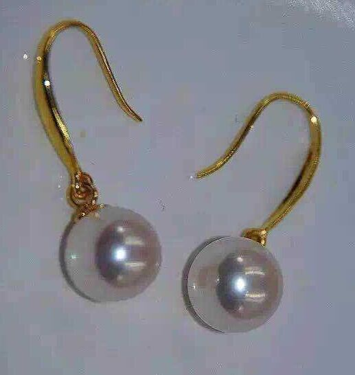 a pair of natural south seas white pearl earrings 14