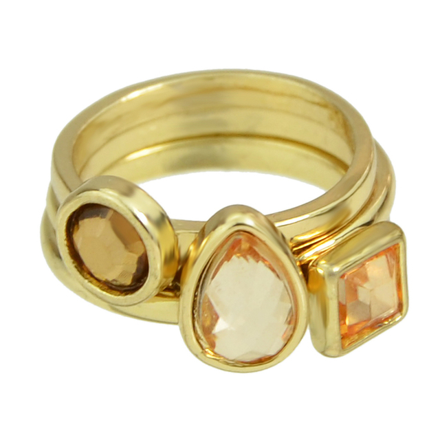 Triple ring with crystals. Gold color