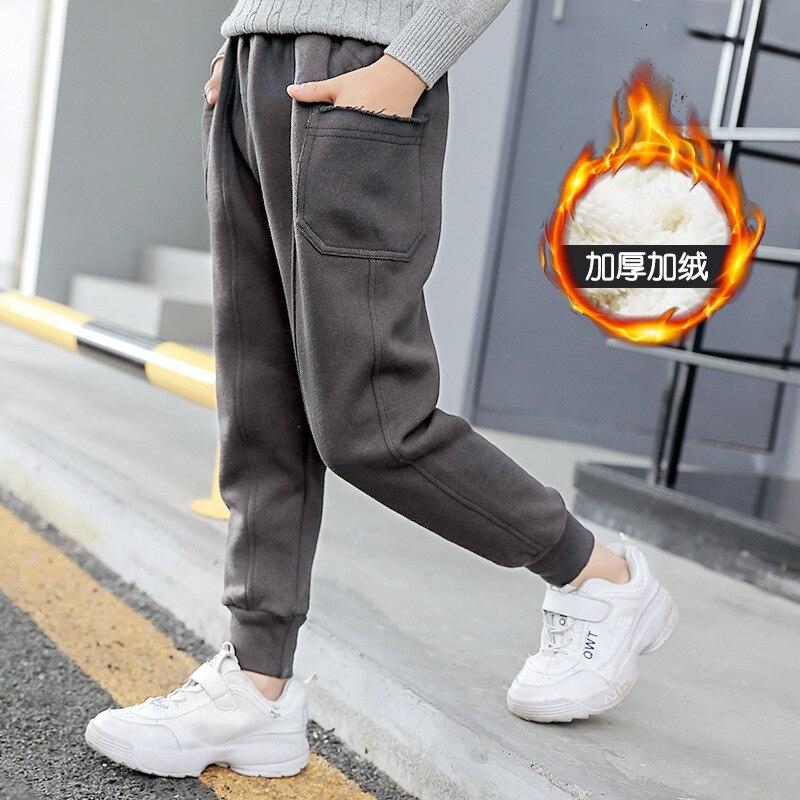 f113532ed Pantalones casuales para niños de terciopelo interior de Color sólido  invierno cálido niños pantalones sin altura