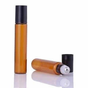 Image 1 - 50 Stks/partij 10Ml Roll Op Draagbare Amber Glazen Navulbare Parfumfles Lege Etherische Olie Case Met Plastic Cap