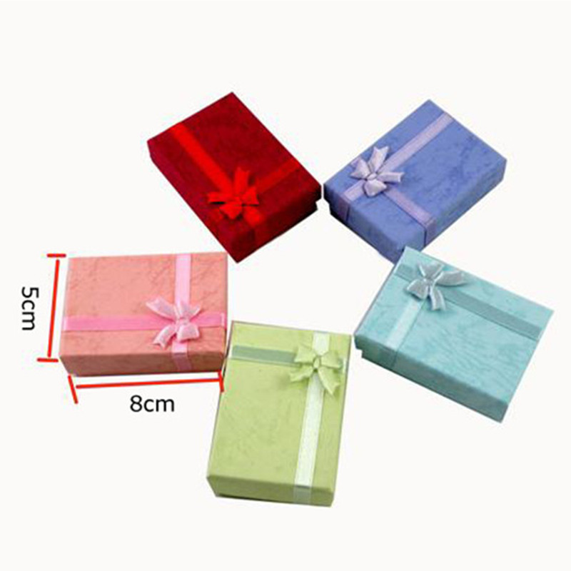 8*5*2.8CM A jewelry box, a pair of rings, or a necklace, a bracelet, a bow, a gift box.Random color