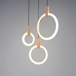 Image 4 - Candelabros LED modernos con caída en escalera, iluminación nórdica para sala de estar, lámparas de techo colgante, anillos de acrílico para dormitorio, accesorios, luces colgantes de madera