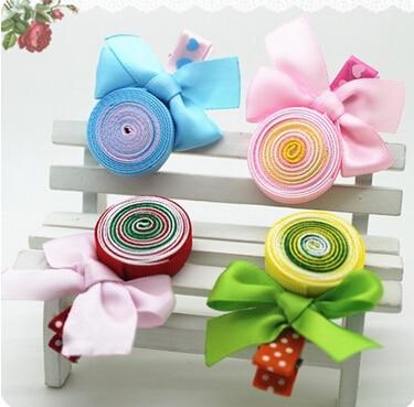 Nuevas muchachas de la impresión de la cinta Lollipops niños accesorios niña del arco accesorios coloridos
