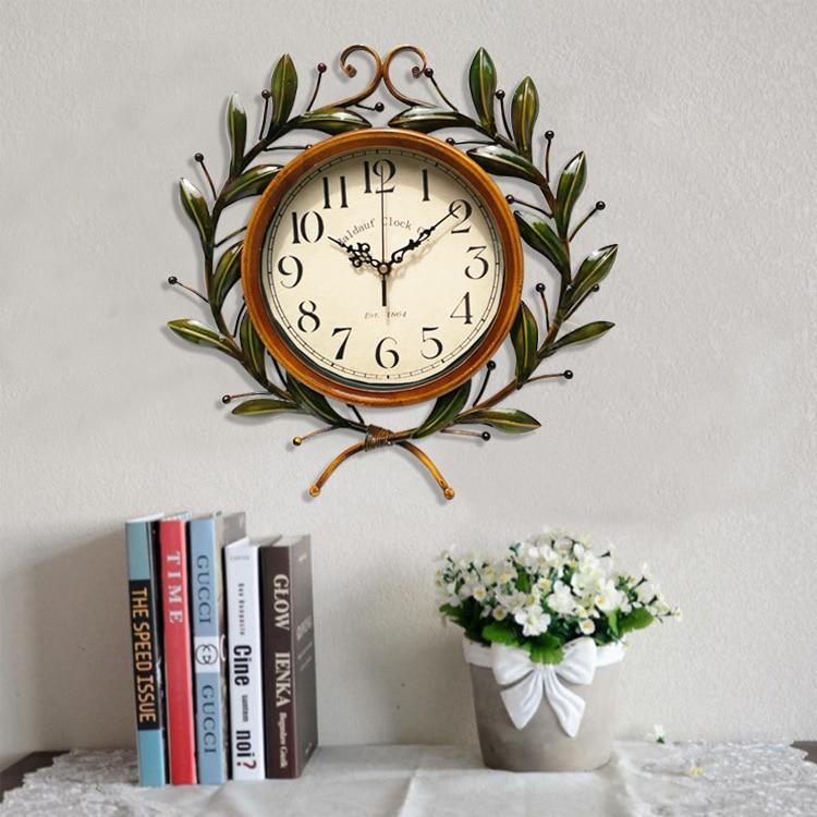 Idyllic Creative Wrought Iron Olive Branch Clock Round Wall Clock Modern Design Living Room Cafe Quiet Decorative Quartz Clock