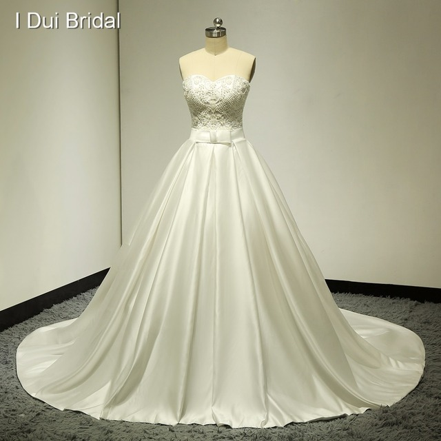 Beaded Strapless Real Wedding Dresses Satin Ball Gown Chapel Train Pocket High Quality Factory Custom Make