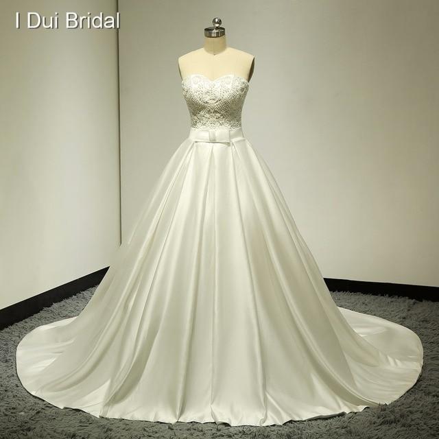 6663e2ba469 Beaded Strapless Real Wedding Dresses Satin Ball Gown Chapel Train Pocket  High Quality Factory Custom Make