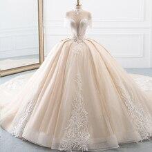 ใหม่มาถึงคอบอลชุดแต่งงานเจ้าหญิง Tulle Hochzeitskleid พู่แขน Abiti da เจ้าสาว Sparkly Robe Mariee