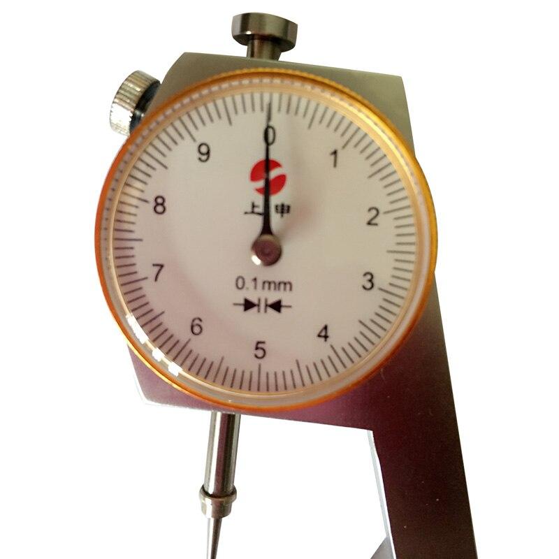 Produto de Laboratório Metal Relógio Mostrando Espessura Dental
