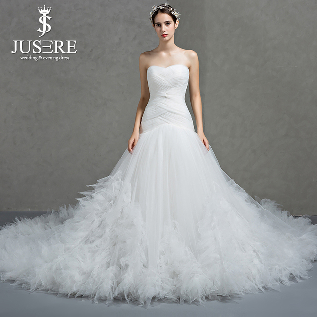 Crisscross Pleat Strapless Neckline Lace Up Back Elegant Bridal Gown Feather Ruffles Tail Indulgent Train