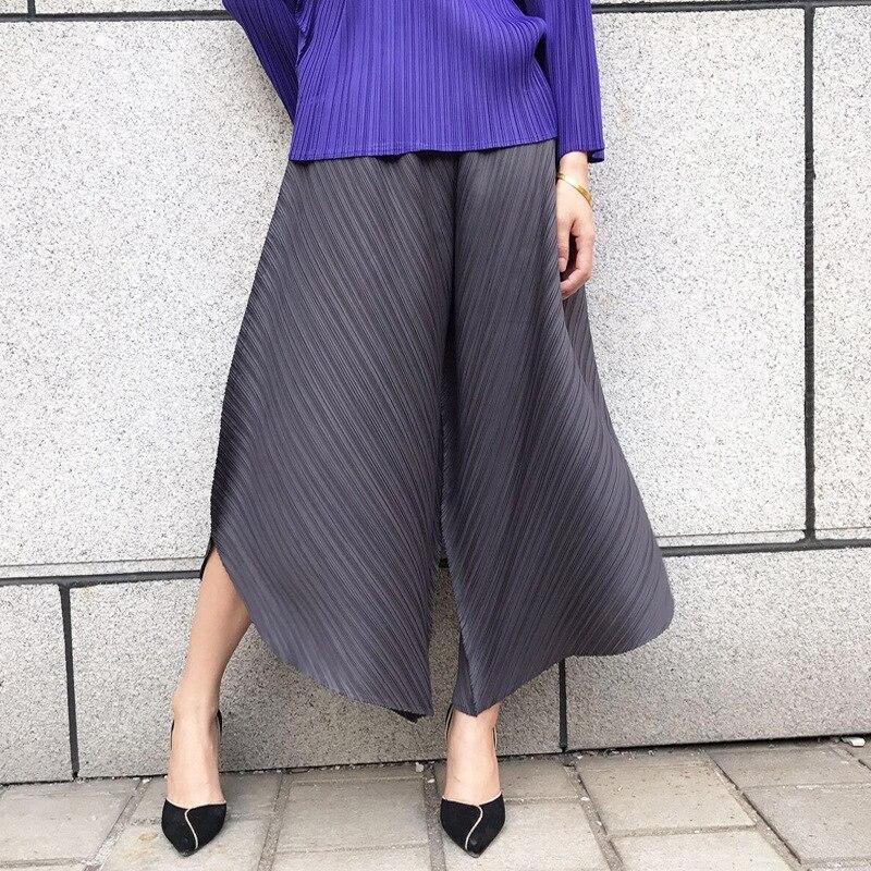 Miyake plis femmes pantalons à jambes larges 2019 été station européenne couleur unie grande taille élastique pantalons décontractés neuf pantalons