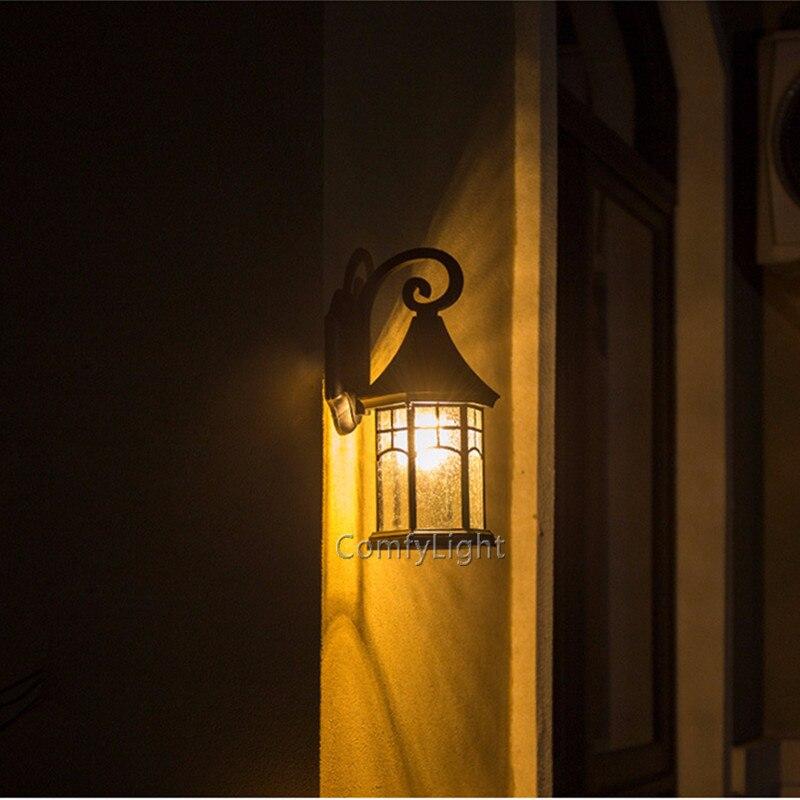 lâmpada de parede ao ar livre LEVOU