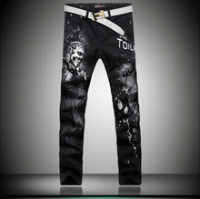 2015 конструктор мужская мода свободного покроя джинсы высокое качество люксовый бренд черепа печать сексуальная тонкий прямой ночные клубы джинсовые брюки черные