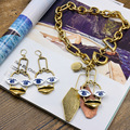 Europe and the United States vintage chain rough face eye earrings retro personality clavicle short necklace 376