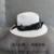 La edición de Han de titanio negro doble M estándar blanco y negro cintas de impresión a ahueca hacia fuera el jazz del sombrero de paja del sombrero del sol