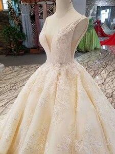 Image 5 - LSS1011 sexy vestidos de noiva sem mangas até o chão apliques v back beleza brilhante vestidos de casamento белый сарафан