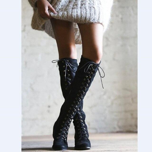 Imagenes de mujeres con vestido y botas