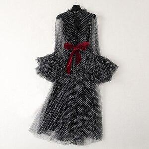Image 1 - Robe longue noire, à manches longues, à mailles évasées, à la mode, vêtement de soirée, vente en gros
