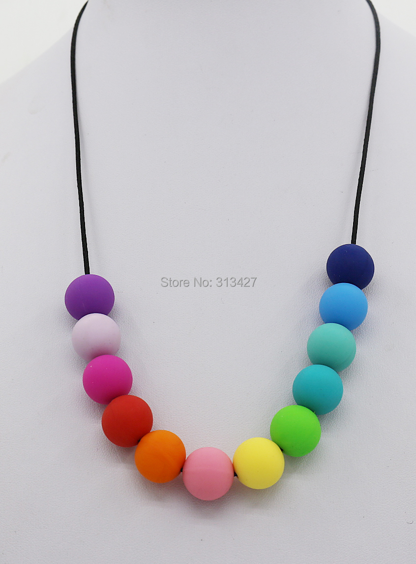 2Pcs/lot Free Shipping -Month/Daughter Silicone Teething Necklace Rainbow necklace ,BPA free Silicone Necklaces for baby chewed