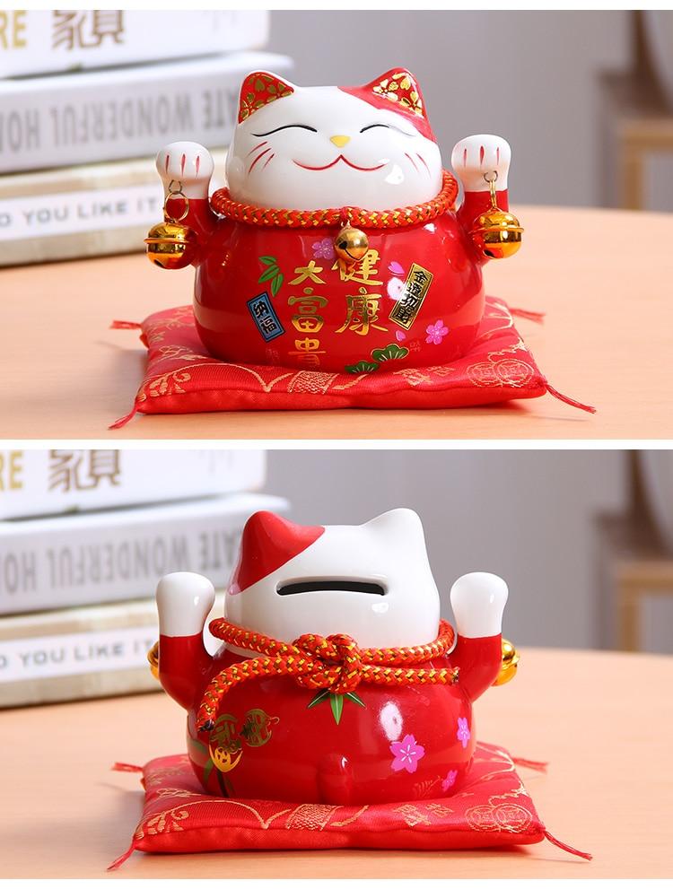 Foto Maneki Neko (Gato de la suerte) de cerámica color rojo para la salud y el dinero