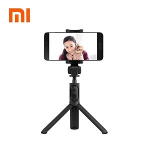 Image 1 - 100% המקורי xiaomi כף יד מיני חצובה 3 ב 1 דיוקן עצמי חדרגל טלפון Selfie מקל Bluetooth אלחוטי מרחוק תריס שחור