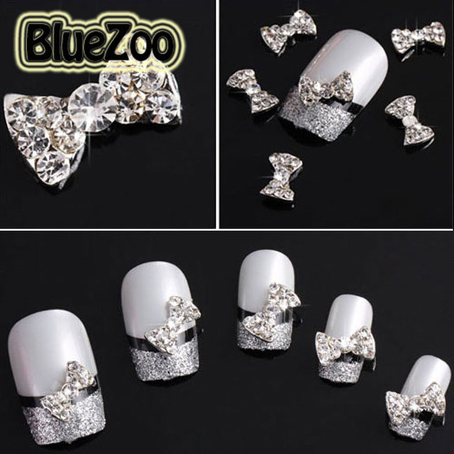 BlueZoo 100pcs/pack 3D Clear Alloy Rhinestones Bow Tie Nail Art Decorations Glitters Slices DIY Nail Stud Make Up Tips