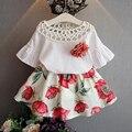 Ху солнце оптовые новые 2017 мода лето Девушки цветы выдалбливают блузка + юбки 2 шт. комплект одежды