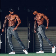 Men Gyms Long pants Cotton Men's gasp workout fitness Pants casual Fashion sweatpants jogger pant skinny trousers Hip Hop