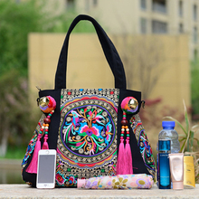 Luxurious Embroidered Handbag With Tassels