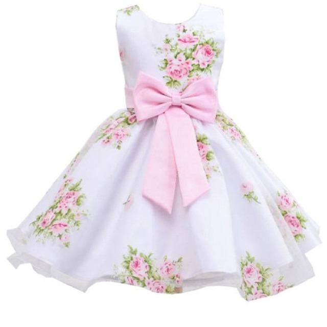 Venta al por menor nuevo estilo del verano del bebé de impresión niña vestido de flores para muchachas de la boda vestido de fiesta con el arco para 2-8 Años LM008