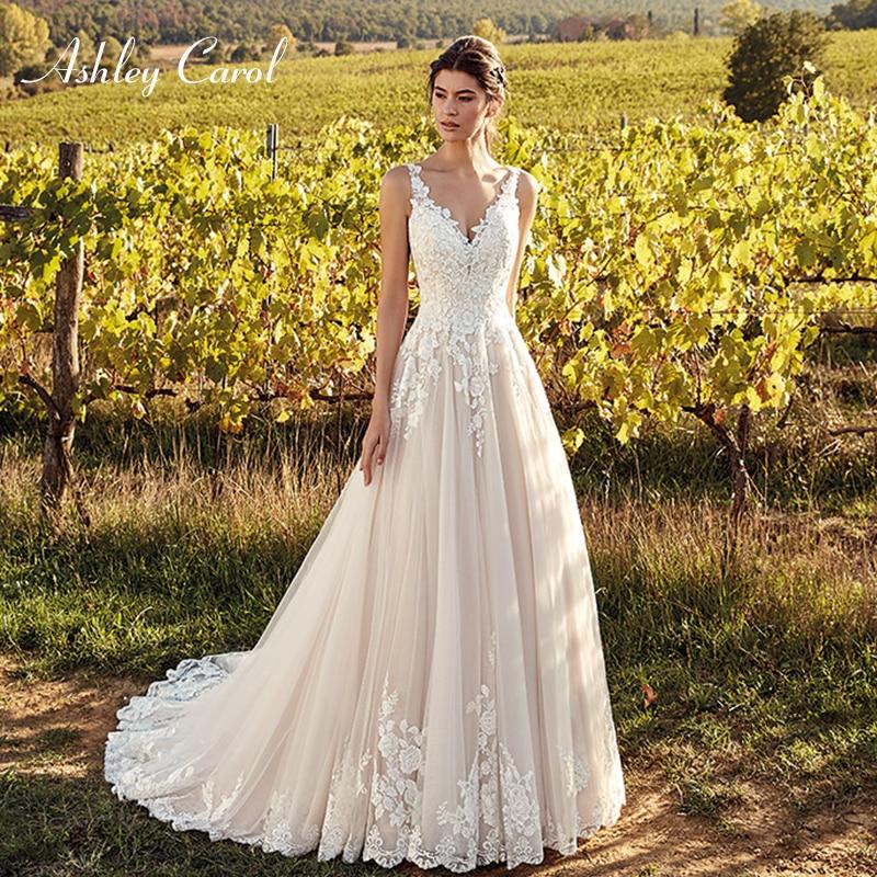Ashley Carol Sexy V-neck Backless Tulle Wedding Dresses 2019 Spaghetti Straps Court Train Bridal Dress Elegant Wedding Gowns