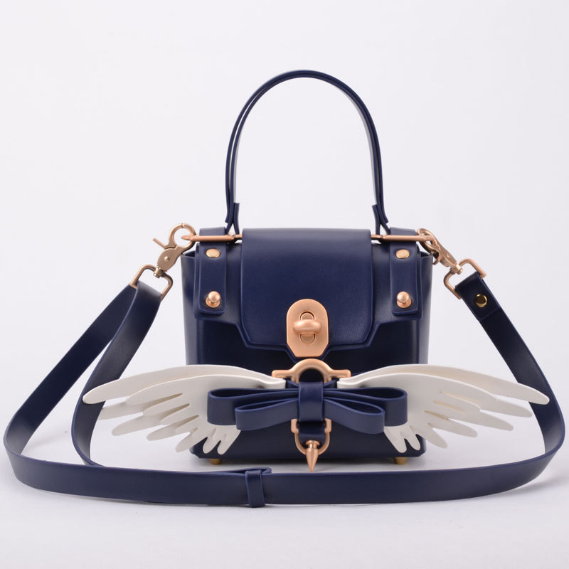 The Hot Korean version of the butterfly bow with coloured wings, one shoulder handbags, personalized rivet mini squint small