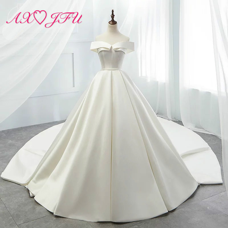 8c782e9dfc8 AXJFU luxury princess vintage boat neck white satin wedding dress French  parsimony Europe fashion new ruffles