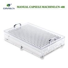 ماكينة تعبئة الكبسولة اليدوية CN 400 000 # 5 # بغلاف بثقوب 400