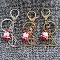 Christmas Gift Handmade Harry Potter Keychain Triangle Pendant with Santa Claus Bell Key Chain Cute Bag Pendant For Women Men