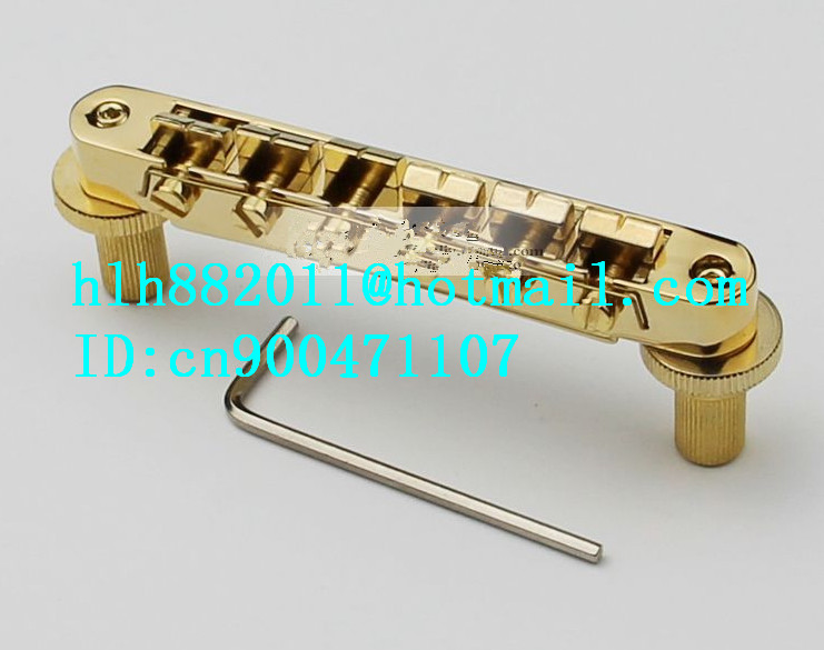 free shipping new  electric guitar bridge BM002 in gold   SU-8 free shipping new electric guitar jade tuning peg in gold guitar button wj44 n22